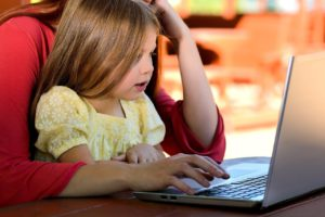 parent and child learning on computer