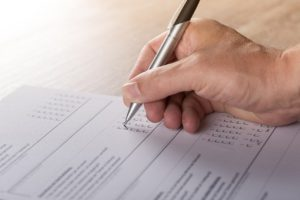 person filling out form